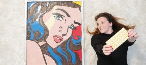 Ann Reardon and her Wonder Woman Pop-Art piece made entirely out of chocolate. | Photo from How to Cook That